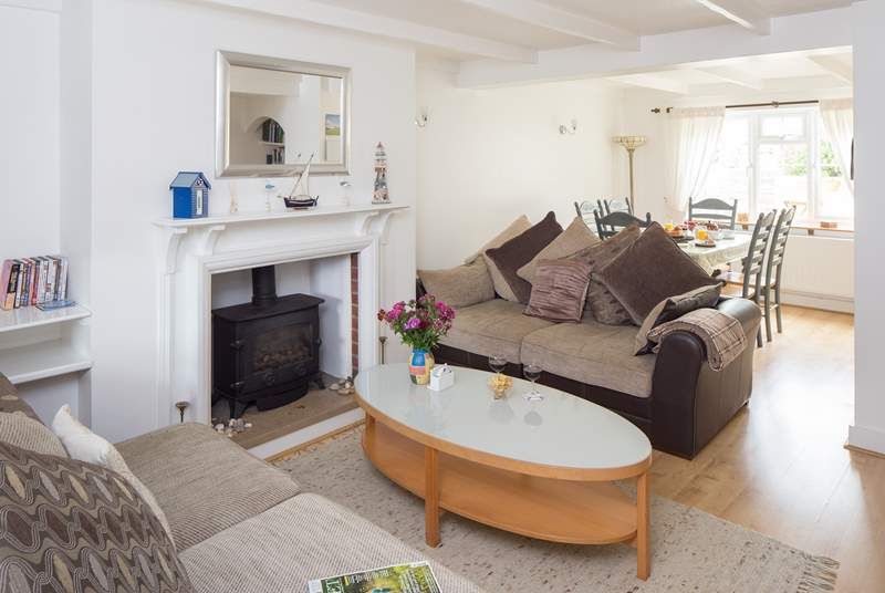 The open plan sitting/dining-room is a lovely sociable space with dual-aspect windows.