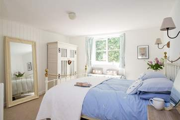 Bedroom 1 is furnished in soft blue and white.