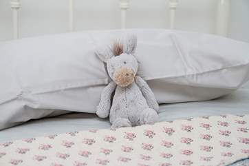 A cuddly toy in the twin bedroom.