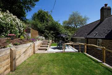 There is a grassed area as well as a slate patio on the lower terrace.