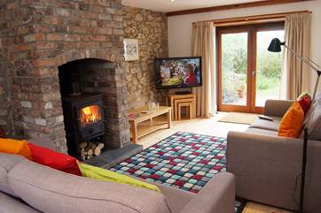 The sitting-room is very cosy with two large sofas to snuggle up on and a 42