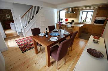 The dining-area is spacious for four guests and the kitchen-area has fabulous view down across the grounds.