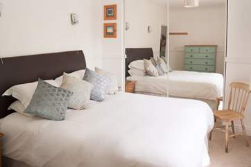 The lovely double bedroom with 5' double bed and lots of storage.