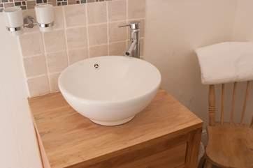Both bedrooms have wash-basins which are both stylish and convenient.