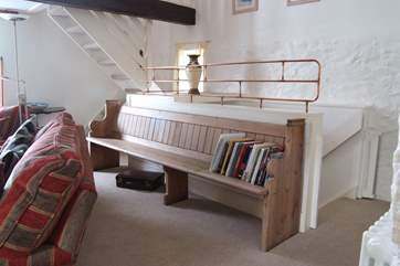 The owners have thought of everything, even crafting a bespoke railing at the top of the stairs.