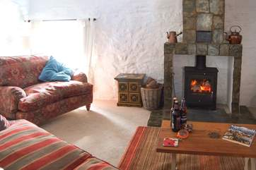 The cosy wood-burner will keep your toes toasty on those cooler evenings.