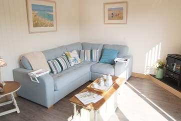 The open plan living-room has a comfy corner sofa.