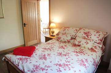 The delightful and spacious bedroom with en suite shower-room.