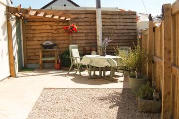 Your private patio is a real sun-trap and there is a gas barbecue and lockable bike/surfboard store.