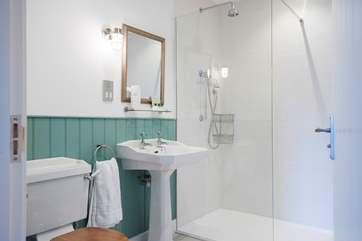 Beautiful bathrooms with fluffy towels and soft white robes are awaiting you.
