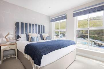 This gorgeous bedroom with super-king size bed is flooded with light.