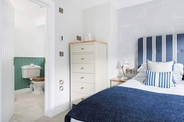 This lovely bedroom has an en suite shower-room.