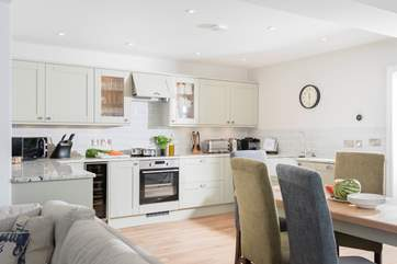 The open plan living-room is light, spacious, beautifully furnished and very well-equipped.