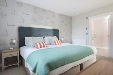 Bedroom 3 is also en suite and has a large walk-in shower next door.