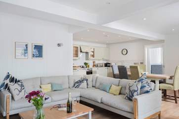 This light contemporary interior has been beautifully designed and furnished with quality and comfort in mind.