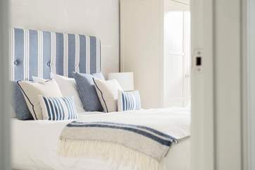 Quality beds, crisp white linens and gorgeous soft furnishings can be found throughout this super apartment.