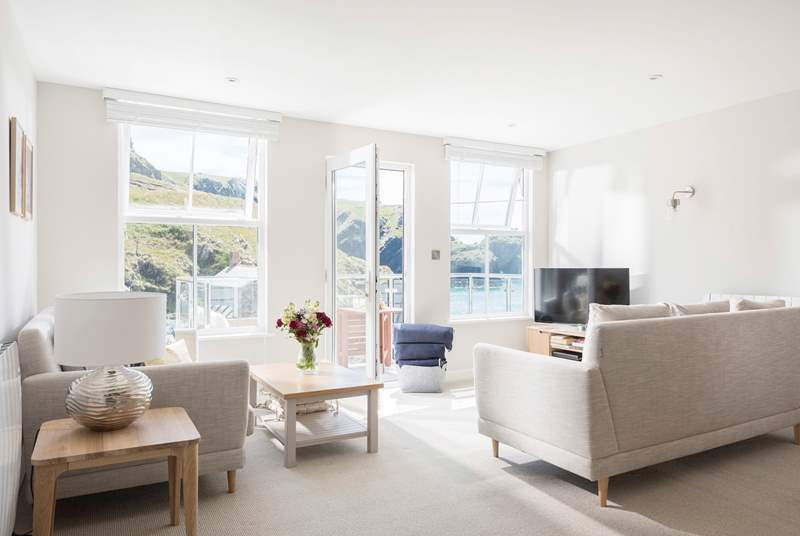 The light and spacious open plan living-room is flooded with light from the large windows and door leading out onto your private balcony.