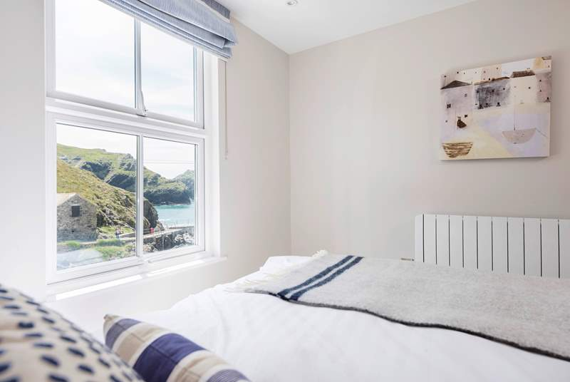 This bedroom has a rather good view without leaving the comfort of the crisp cotton sheets.