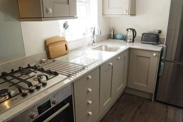 Granite work surfaces and top quality appliances show the level of care taken to fit the cottage out.
