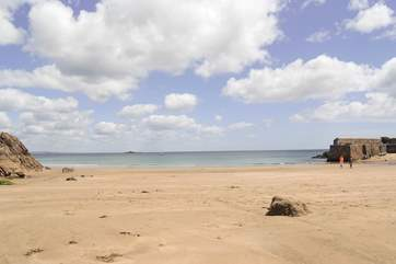 The sandy beach at low tide...safe and sheltered, and perfect for families.