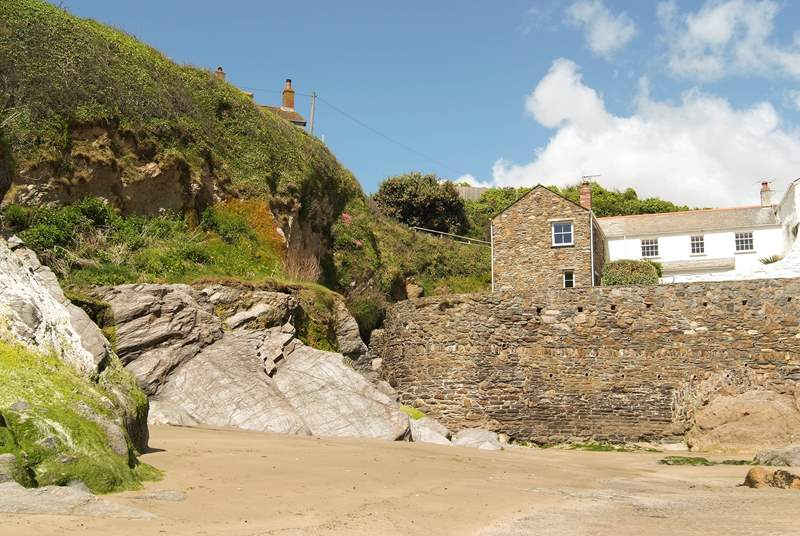 2 Fort Cottages is above the stone sea wall.