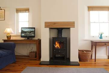 The wood-burner makes the sitting-room a great place to relax in winter too.