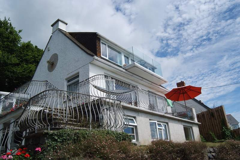 Anchors Rest is a ground floor apartment in this three-storey house overlooking the bay.