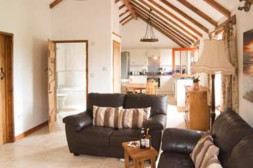 The open plan living-room is light and spacious with lovely high ceilings.