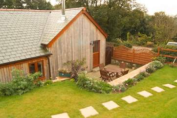 This delightful cottage has the look and character of a traditional wooden cabin.