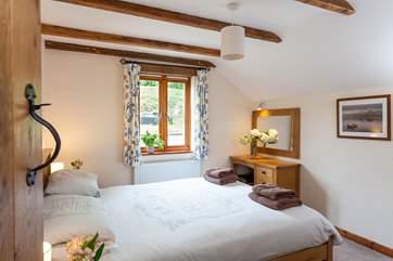 The master bedroom with 5' double bed is next door to the bathroom.