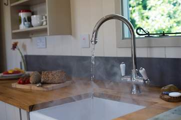 Of course there is hot running water to your kitchen sink.