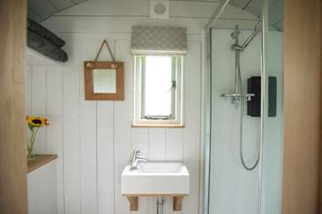 At one end is the beautifully fitted shower-room.