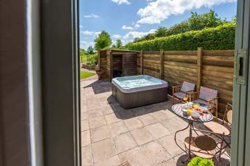 Sheltered and secluded, relax in the hot tub and make the most of the countryside views.
