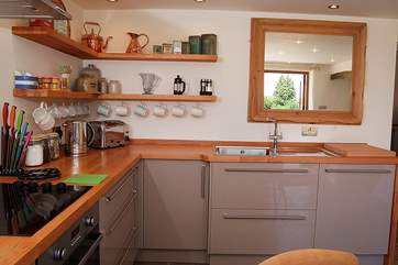 The contemporary kitchen design not only suits the cottage perfectly but is so easy and functional, with plenty of worktop space too.
