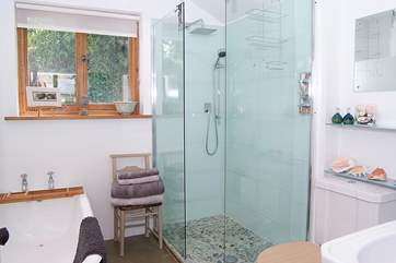 There is a lovely deep bath as well as a walk-in shower.