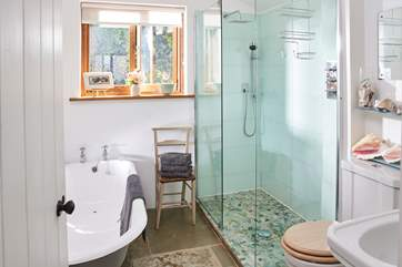 The downstairs bathroom has been beautifully designed, with a lovely deep bath as well as a walk-in shower.