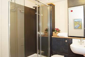 The shower-room has a super-size shower cubicle and a rainfall shower head.