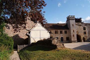 This is the courtyard setting with Castle House to the left of the tower - you can see the windows of the first floor living-room. In the foreground is a fully restored medieval Alms House.