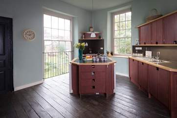 There is a stylish kitchen with views over the gardens of the Castle Hotel.