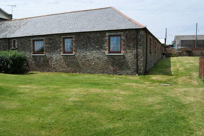 The Old Byre basks in sunshine and has a really large enclosed garden.