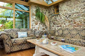 The conservatory leads off from the kitchen and can provide a quiet place to escape to.