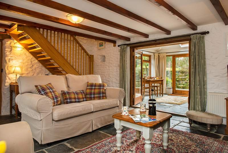 The cosy sitting room leads out to the conservatory