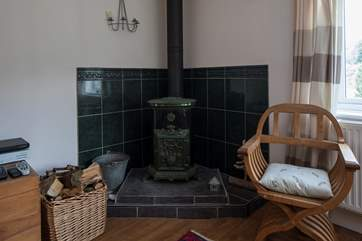 The French-style wood-burner throws out some delightful heat.