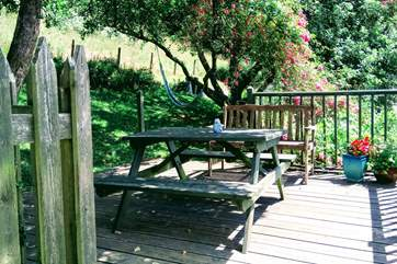 The patio is found outside the kitchen door with the meadow beyond. What a fabulous place to sit and dine al-fresco.