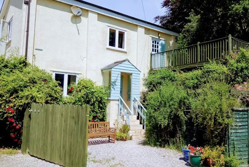 The front of this lovely property is approached by five steps.