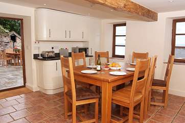 There is a lovely family-sized dining-table and plenty of room for seven in this super kitchen.