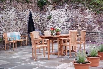 The terrace is accessed from the kitchen - a wide and sunny area with plenty of seating, a large parasol and a barbecue.