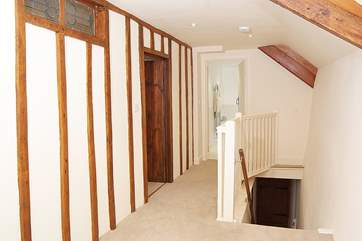 Even the landing is an attractive feature in this cottage. There is a stair-gate at the bottom of the stairs to help you keep your dogs downstairs!