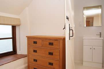 This bedroom comes with its own en suite shower-room. The lovely deep windowsills in all the bedrooms make the most of the sea views.