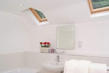 The family bathroom is integrated with the bunk-room - accessed from the landing. An unusual design as there is no door to the bedroom but there is from the landing.
